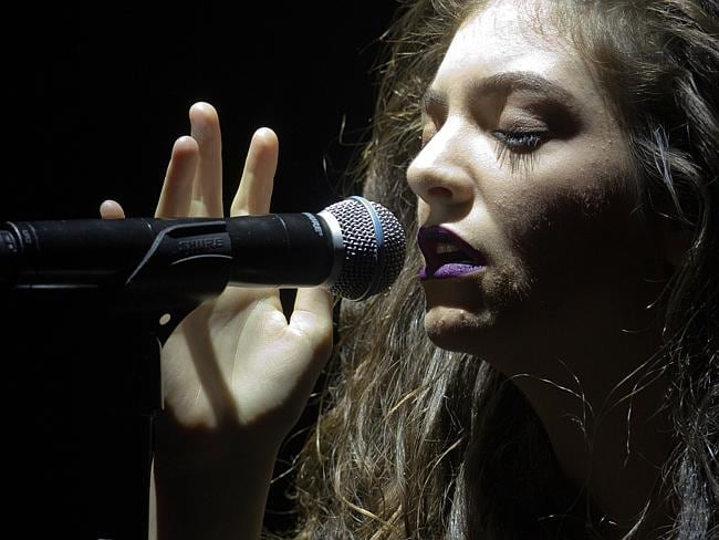 Singer-songwriter Lorde is proud of achieving success on her own terms. / Evan Agostini / Invision / AP