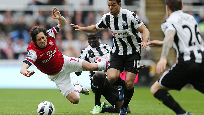 Arsenal's Tomas Rosicky (L) goes down under a challenge from Newcastle United's Hatem Ben Arfa in the English Premier League clash at St James' Park. Arsenal won 1-00. Picture: Ian MacNicol
