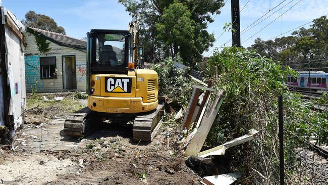 The bulldozers are at work knocking down an abandoned house used by druggies. Picture: Steve Tanner
