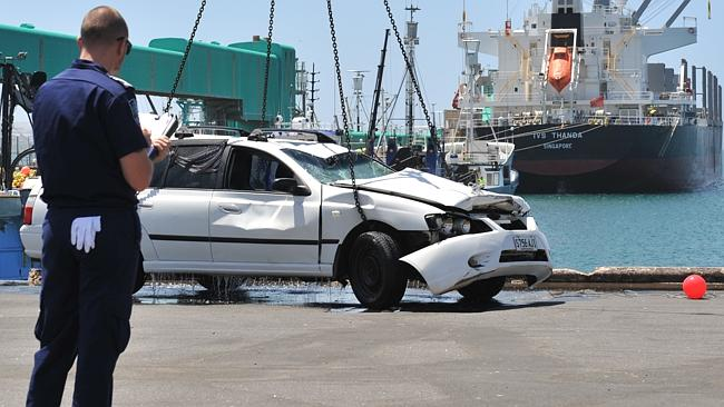 The Ford Falcon station wagon is lifted from the water on to the Port Lincoln wharf. Picture: Ivon Perrin