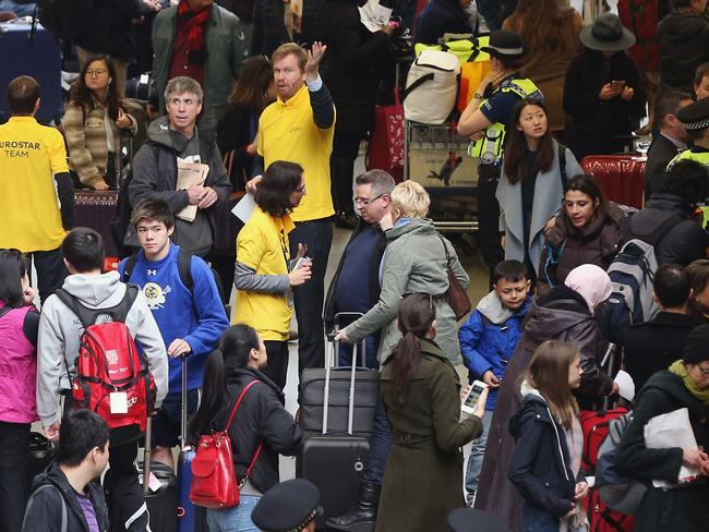 Passengers wait at the entrance to the Eurostar in London after services were disrupted in the wake of the attacks. Picture: Dan Kitwood/Getty Images.
