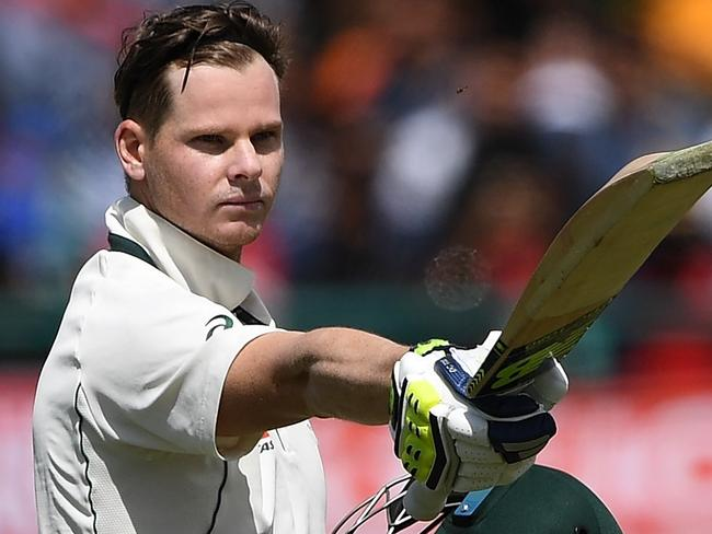 Australia's captain Steve Smith raises his bat and helmet as he celebrates after scoring a century (100 runs) during the fourth and last Test cricket match between India and Australia at The Himachal Pradesh Cricket Association Stadium in Dharamsala on March 25, 2017. ----IMAGE RESTRICTED TO EDITORIAL USE - STRICTLY NO COMMERCIAL USE----- / GETTYOUT---- / AFP PHOTO / PRAKASH SINGH / ----IMAGE RESTRICTED TO EDITORIAL USE - STRICTLY NO COMMERCIAL USE----- / GETTYOUT