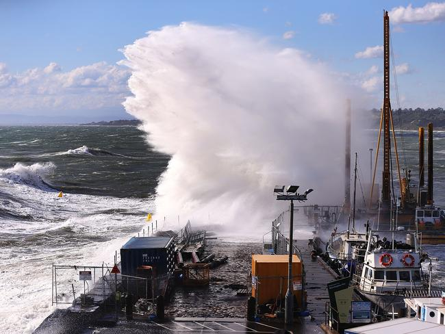 Gigantic waves crash into Mornington harbour. Picture: Getty Images