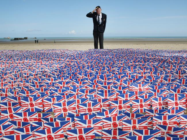 ASNELLES, WE SALUTE YOU: World War II veteran Fred Holborn pays his respects as he looks over 20,000 British flags at Gold beach, one of the sites of the D-day landings in Normandy 70 years ago.   Picture: PETER MACDIARMID/GETTY IMAGES