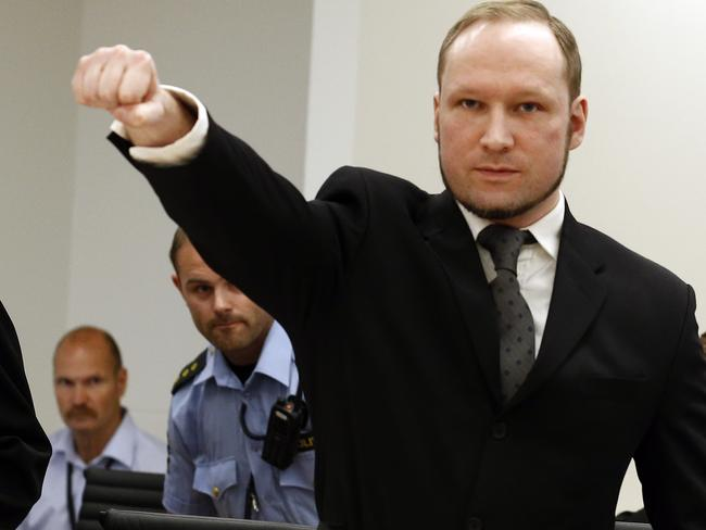 Mass murderer Anders Behring Breivik, making a salute after his arrival at the courtroom in Oslo in August 2012. Picture: AP