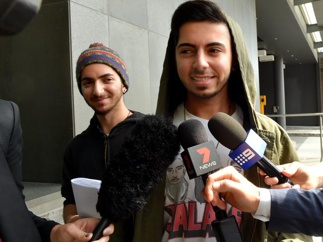 Two of the Jalal brothers, known for posting prank videos imitating terrorists by filming fake bomb stunts and drive-by shootings, are released from custody at the Spencer St Police Station in Melbourne yesterday. Picture: AAP Image/Tracey Nearmy