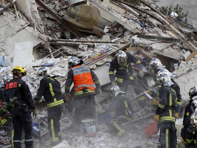 Nine missing ... French firemen search for survivors, with nine people still missing and two dead after an apartment building collapse. Picture: AP