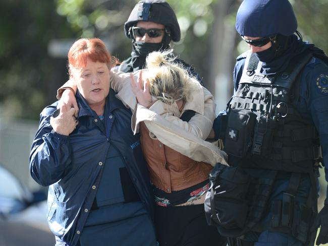 One of the hostage is escorted away by police from the scene. Picture: Tom Huntley