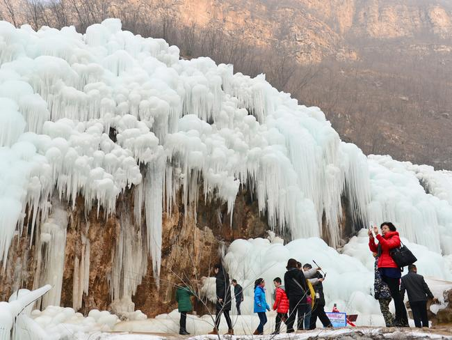Tourists have flocked to the frozen waterfall. Picture: Xinhua/Zuma/Australscope