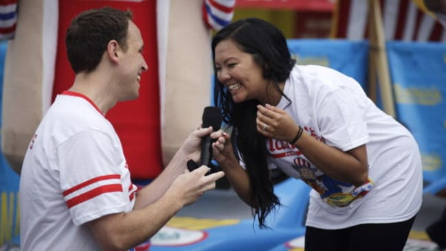 Joey Chestnut proposes to his longtime girlfriend Neslie Ricasa at the 98th annual Nathan's Famous Hot Dog Eating Contest in New York City. Photo: Kena Betancur.
