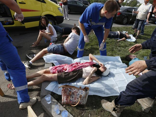 Crash ... Paramedics treat passengers injured as several subway cars derailed in Moscow. Picture: AFP