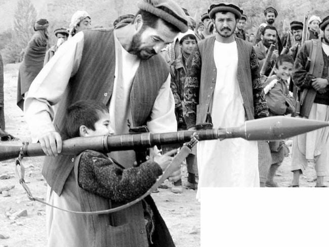 Being trained ... an Afghan child, age 5, being trained as a Northern Alliance soldier in Afghanistan.