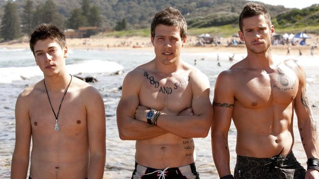 Actors (L-R) Lincoln Younes, Stephen Peacocke and Dan Ewing, who call themselves the River Boys, make their debut in scene from TV series  <i>Home and Away</i>.
