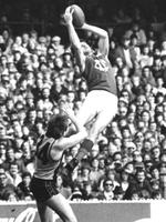 Roos takes a towering mark for Fitzroy over Hawthorn's John Kennedy Jr.