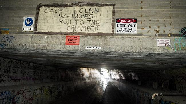 A Cave Clan sign in a storm water drain under the surface of Melbourne. Picture: Jason Ed