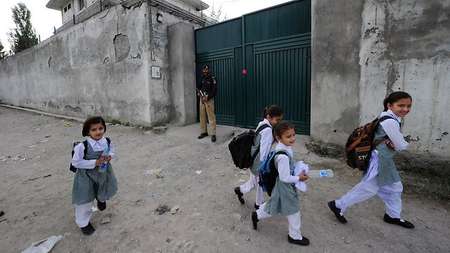 Pakistani schoolgirls walk past the hideout house of Osama bin Laden in Abbottabad. Picture: AFP