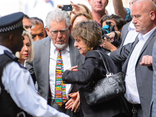 Chaotic last moments of freedom ... Rolf Harris walks through the scrum of media and onlookers outside court acompanied by his daughter Bindi and niece Jenny, shortly before he was locked up.