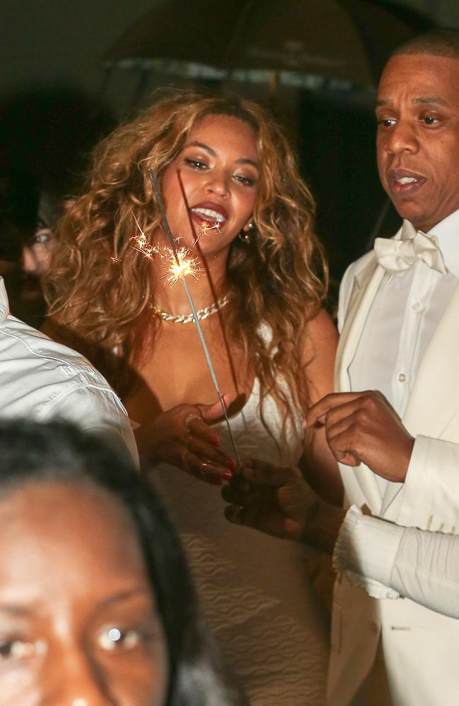 Sparkling success: Beyonce and Jay Z as the happy couple celebrate their wedding. Picture: Snapper