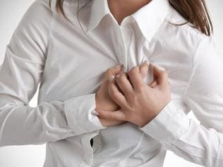 Generic photo of a woman having a heart attack - chest pains. Picture: iStock