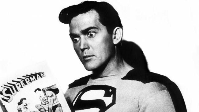 Actor Kirk Alyn (1910-1999), the first screen Superman, reading a Superman comic. Picture: Supplied