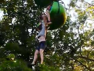 A screen capture of the 14-year-old girl dangling from a gondola ride in New York state. Picture: Facebook