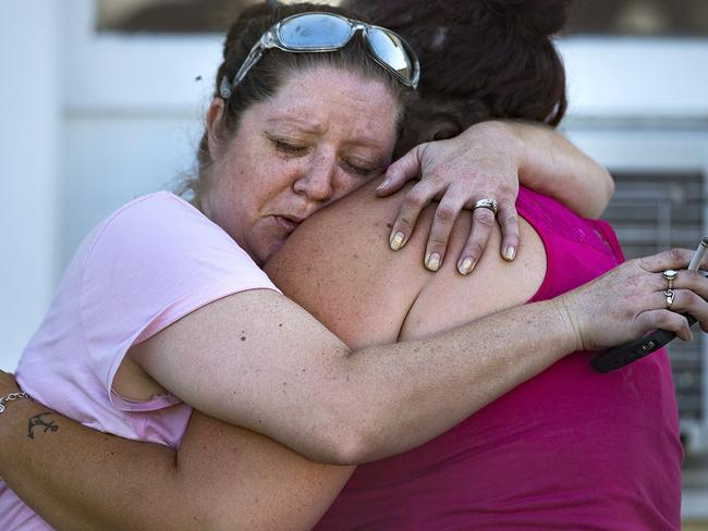 Carrie Matula embraces a woman after the shooting that has killed at least 27 people. Picture: AP