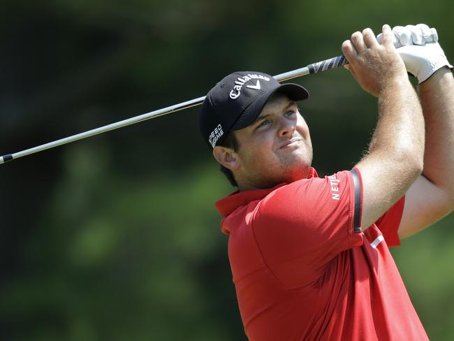 Patrick Reed watches his tee shot on the second hole during the final round of the Quicken Loans National PGA golf tournament.