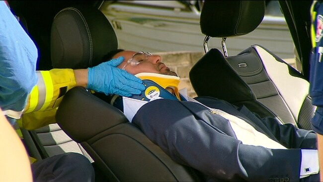 Salim being put into an ambulance after the crash last year. Photo: Seven News