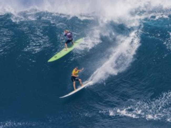 Laura Enever, upper left, and Felicity Palmateer, ride a wave at Jaws, Pic: WSL.