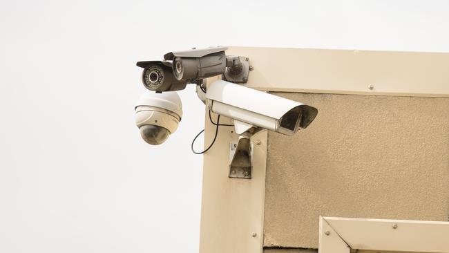 An outdoor security camera on a home. Image: AAP/James Elsby.