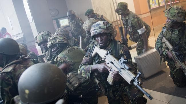 Armed police leave after entering the Westgate Mall. Picture: AP