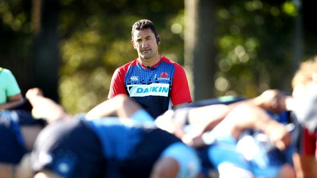 Daryl Gibson watches his forwards scrummage during a Waratahs training session at Bus Loop Oval.