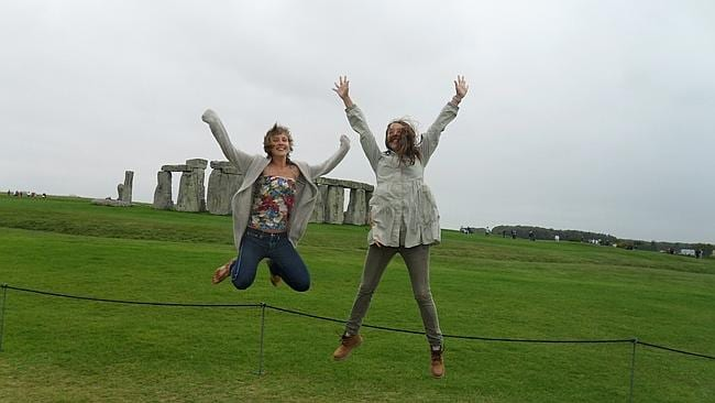 Jumping around to keep warm at Stonehenge with a new friend. Picture: Tatyana Leonov