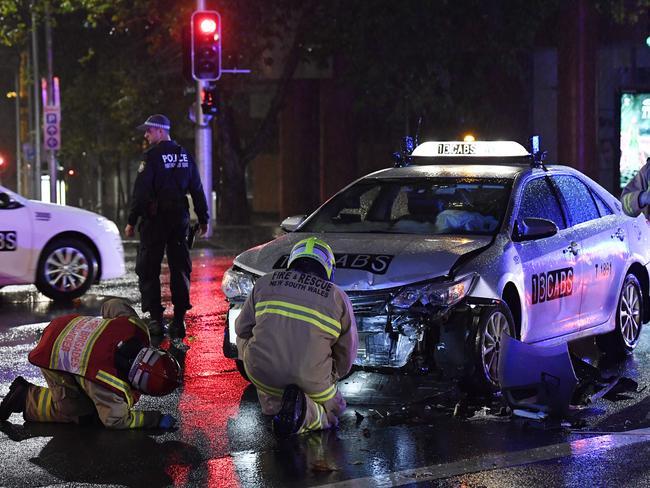 A taxi collided with a car in Macquarie Street early this morning, trapping the driver. Picture: Gordon McComiskie