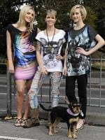 <p>Ruby Rose had a pop up fashion show on a tram for the 2010 Melbourne Fashion Week. Waiting at the tram stop with her dog Daisy and two of the models. Daisy is the dog on Ruby's t-shirt. Picture: Ellen Smith</p>