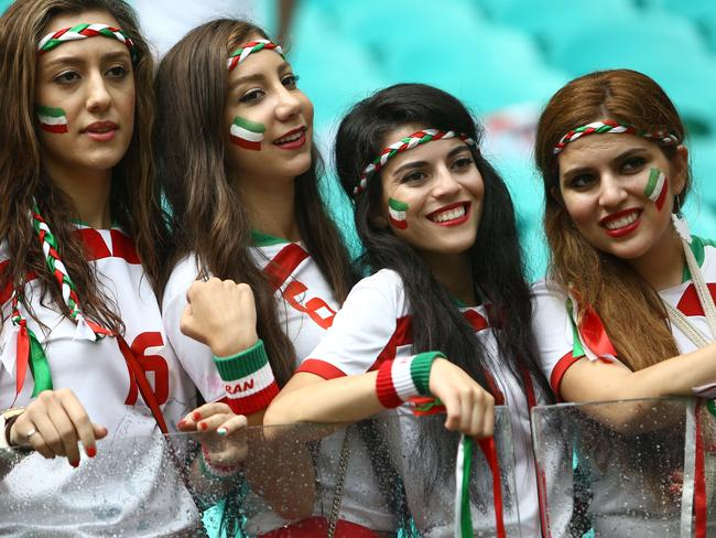 Fans of Iran pose during the match between Bosnia-Herzegovina and Iran at the Fonte Nova Arena in Salvador.
