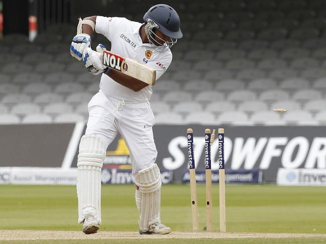 Sri Lanka's Kumar Sangakkara is bowled by England's James Anderson for 61 runs during the fifth and final day's play.