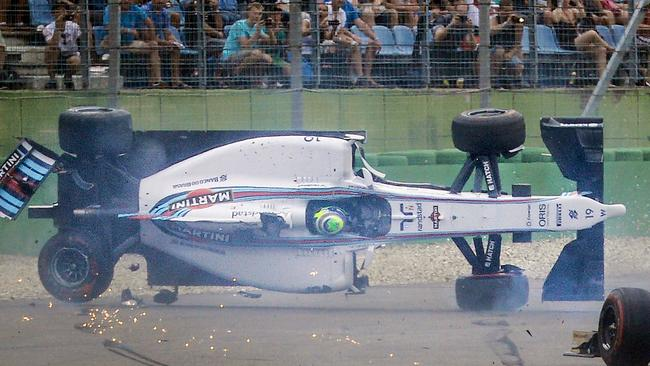 Williams driver Felipe Massa of Brazil crashes at the first curve.