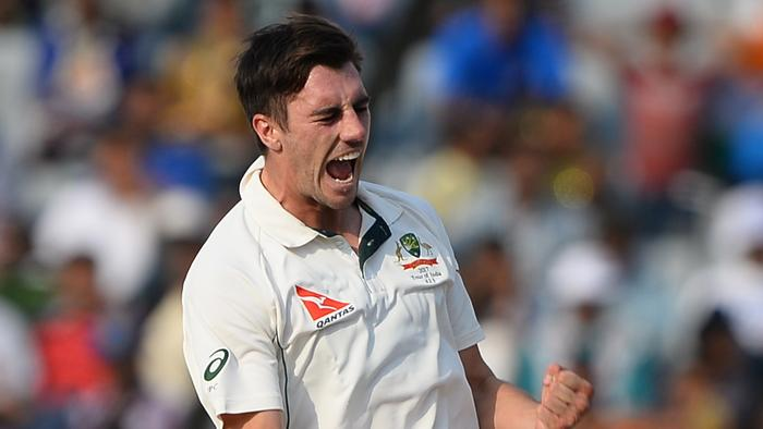 Australian bowler Pat Cummins celebrates after dismissing KL Rahul on day two.