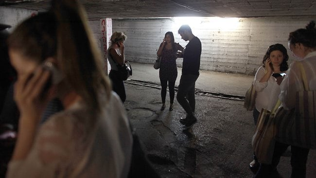 Israelis take cover in a bomb shelter in central Tel Aviv as sirens warn them of a possible rocket strike. Picture: AFP