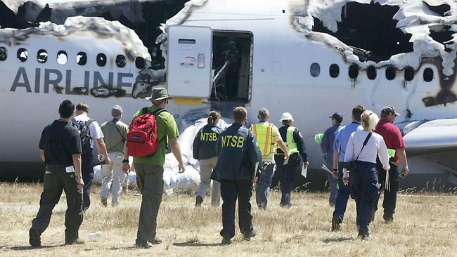 The NTSB investigative team arriving to inspect the wreckage of Asiana Flight 214