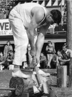 The winner of the Wooltana underhand log-chop handicap at the 1964 Royal Adelaide Show was one F. Whiteside, of Victoria. Here he completes his winning chop.
