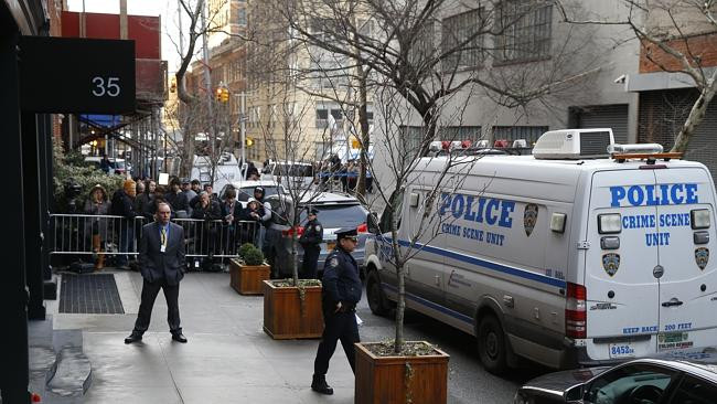 Shocked ... the scene outside the home of Philip Seymour Hoffman.