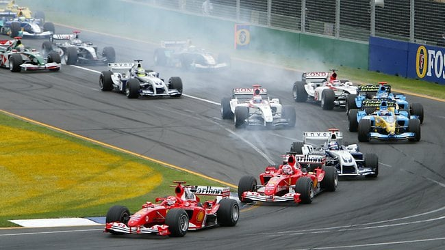Ferrari driver Michael Schumacher leads the field into turn 1 at the 2004 Australian Grand Prix. Picture: David Caird