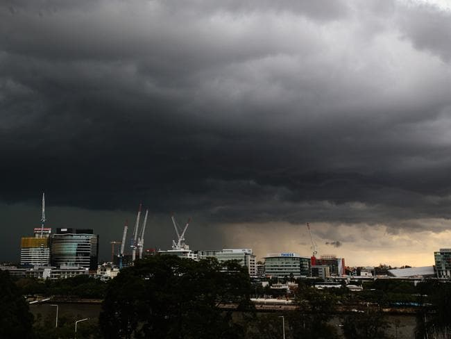 Giant hail and damaging winds lashed the east coast, with asthma sufferers advised to be on high alert. Pictured, the view from Brisbane's Parliament House. Picture: Jono Searle