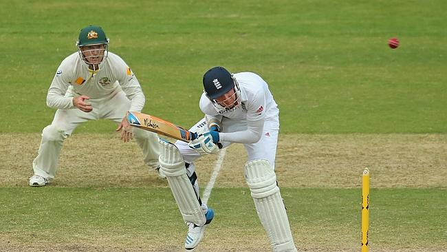 England's Stuart Broad avoids a short ball from Mitchell J...