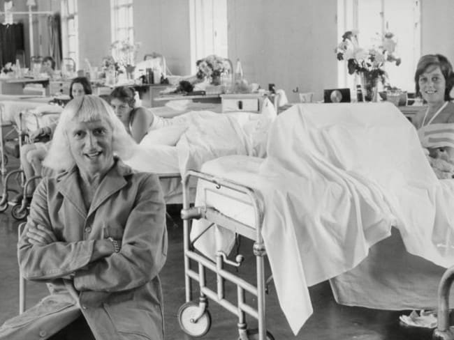 Chilling ... Jimmy Savile with female patients at Stoke Mandeville Hospital, where some of the abuse is said to have occurred.