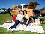 Cara Pearson with her fiance Matt Huijsse and Cara'a 1957 FE Holden Special. Picture: Dylan Coker