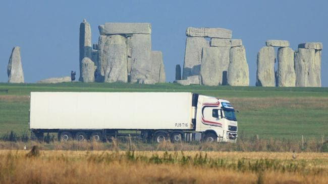 Moving monument ... A truck passes Stonehenge on the A303 road in Wiltshire, England. A 2.9 kilometre tunnel, part of a $3.2 billion upgrade to the road, is intended to eliminate the sound of traffic from the heritage site. Source: AP