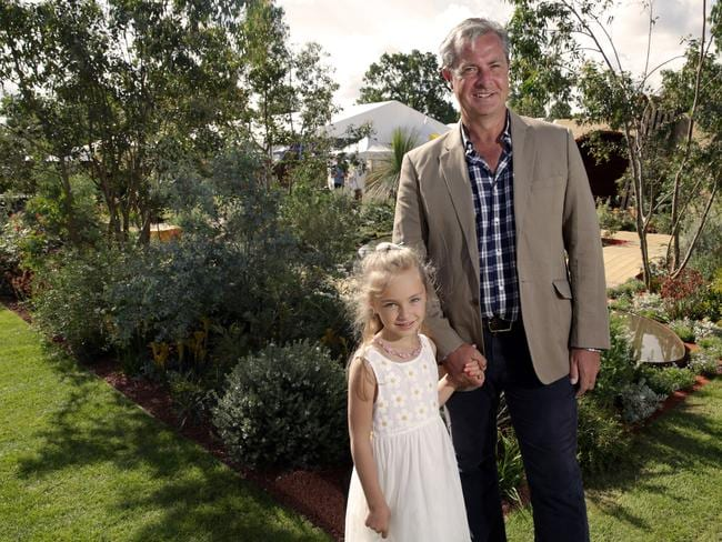 "Green-fingered... Gardener Jim Fogarty and his daughter Lilly, 6, in his prize-winning ""Essence of Australia"" garden at the Hampton Flower Show. Picture: Ella Pellegrini"